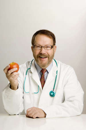 Doctor holding an apple Stock Photo - 3193586
