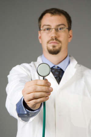 Doctor extending his arm holding a stethoscope Stock Photo - 3193589
