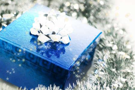 Christmas present among festoon Stock Photo - 3193618