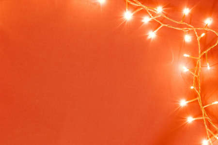 holidays: Christmas tree lights on orange background