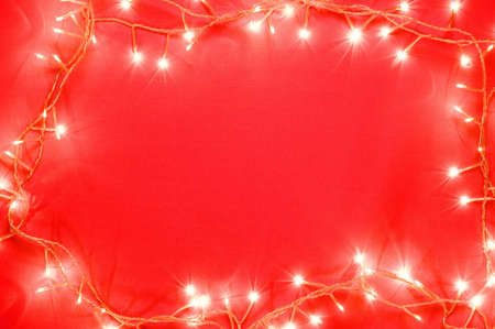 Christmas tree lights on red background Stock Photo - 3193660
