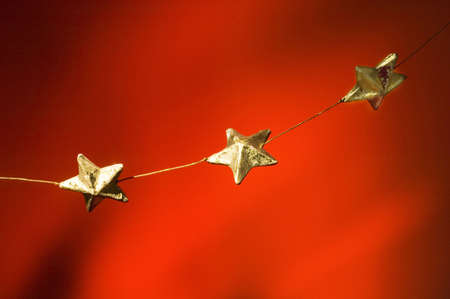 christmas decorations: Christmas stars hanging in a line