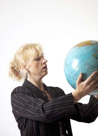 Businesswoman looking at globe Stock Photo - 3193682