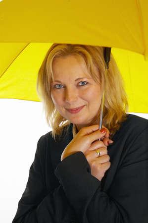 Woman holding a yellow umbrella Stock Photo - 3193685