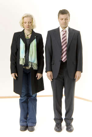 Businessman and businesswoman standing at attention with their eyes closed Stock Photo - 3193699