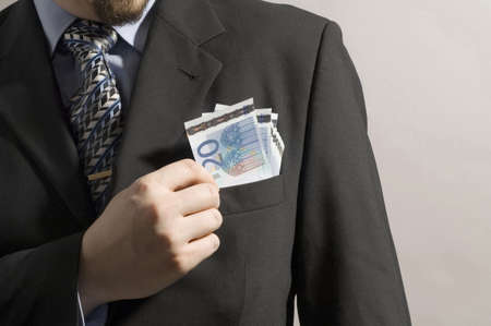 Midsection of businessman taking money from his blazer pocket Stock Photo - 3193705