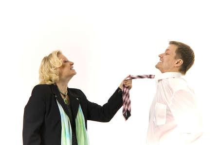 Businesswoman pulling businessman's necktie Stock Photo - 3193707
