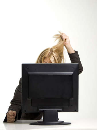 computering: Businesswoman stressed with work
