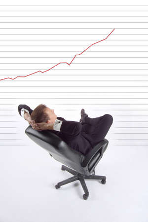 Businessman with laptop and line chart indicating steady revenue increase Stock Photo - 3193711