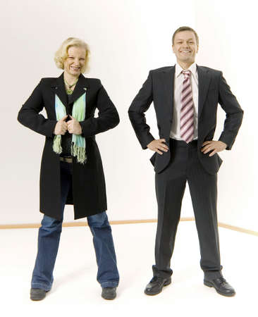Businessman standing beside a funnily dressed businesswoman Stock Photo - 3193729