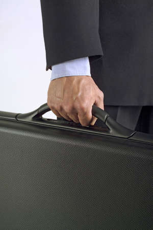 Midsection of man holding a briefcase Stock Photo - 3193730