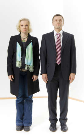 Businessman standing beside a funnily dressed businesswoman Stock Photo - 3193732