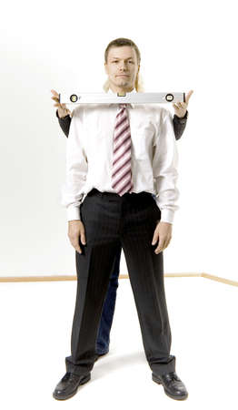 Businesswoman standing behind businessman holding spirit level Stock Photo - 3193744