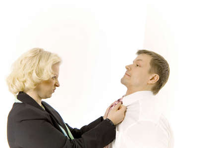threatening: Angry businesswoman pulling businessmans shirt LANG_EVOIMAGES