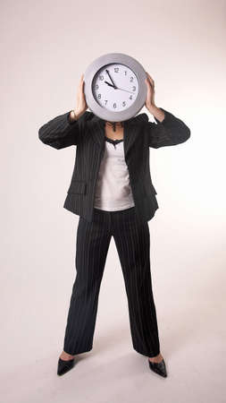 lower section: Businesswoman posing with a clock as her face LANG_EVOIMAGES