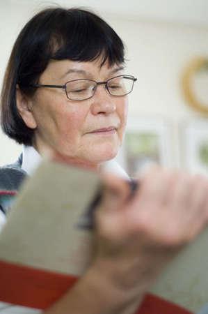 book: Senior woman reading book