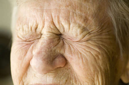 Close up of a senior woman with eyes closed