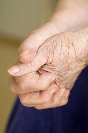 clasping: Senior womans hands clasping together
