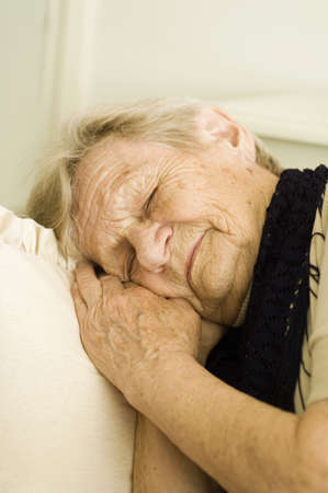 Senior woman taking a nap