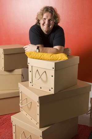 Man posing on stacked boxes Stock Photo - 3193856