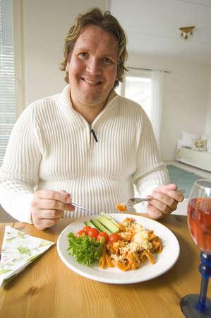 Man smiling while enjoying his meal