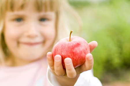 Girl holding red apple LANG_EVOIMAGES