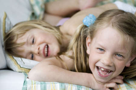 Girls having fun on the bed Stock Photo - 3193865