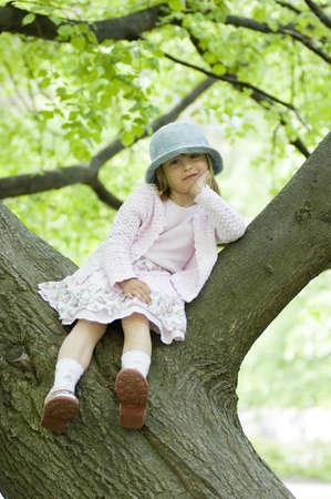 Girl posing on tree branch