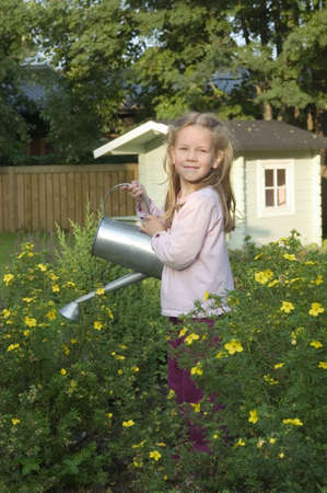 Girl watering plants Stock Photo - 3193878