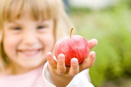 Girl holding red apple LANG_EVOIMAGES