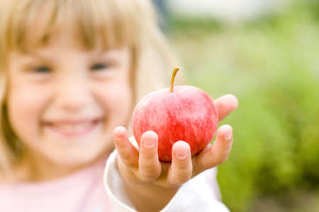 Girl holding red apple Stock Photo - 3193879