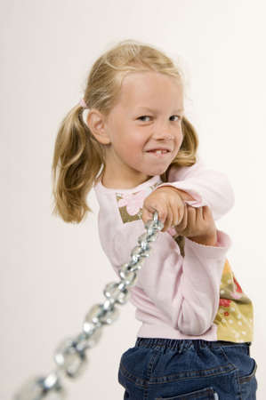 strong: Girl pulling a chain LANG_EVOIMAGES