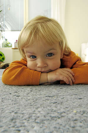 Girl lying forward on the floor looking at the camera Stock Photo - 3193899