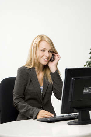 Businesswoman working while talking on the mobile Stock Photo - 3193920