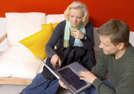 Man and woman using laptop together Stock Photo - 3193922