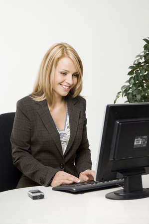 Businesswoman working happily Stock Photo - 3193929