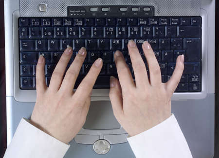 Hands typing on laptop LANG_EVOIMAGES