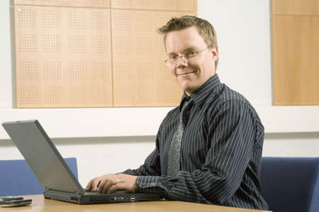 Businessman working on his laptop Stock Photo - 3193944