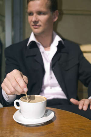 Businessman sitting in a cafe having coffee