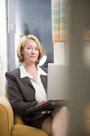 computering: Businesswoman posing with her laptop