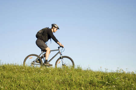 Man with sunglasses riding on a bicycle Stock Photo - 3193985