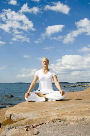 peace and quiet: Woman meditating by the seaside