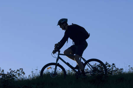 road bike: Silhouette of man riding on the bicycle
