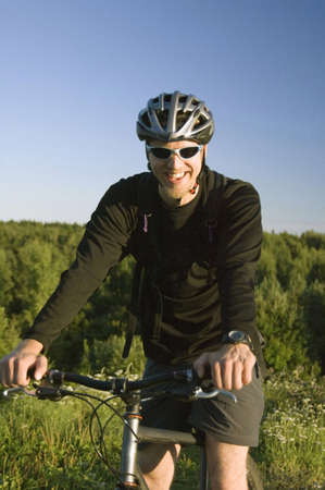Man smiling while riding on bicycle Stock Photo - 3194026
