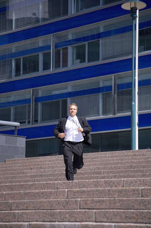 Businessman running down the stairs