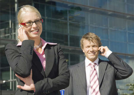 Businessman and businesswoman talking on the mobile phone Stock Photo - 3194037