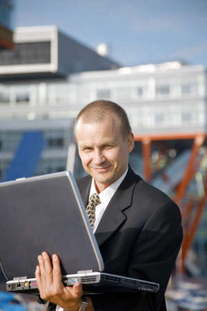 Businessman posing with laptop outdoors Stock Photo - 3194040