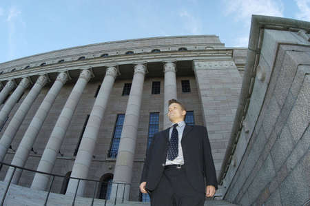 Businessman standing in front of a building Stock Photo - 3194044