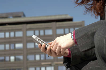 Businesswoman text messaging on mobile phone Stock Photo - 3194054