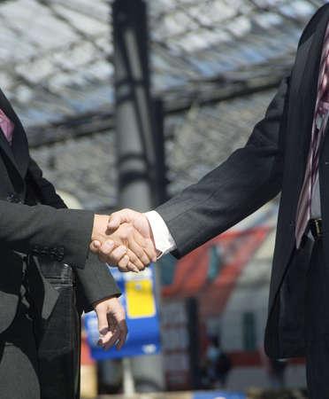 Handshake between businessman and businesswoman Stock Photo - 3194059